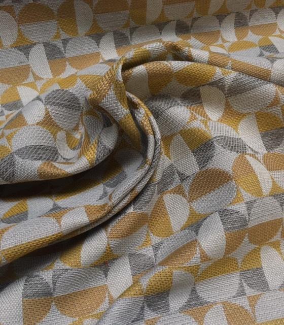 Møbelstof med mønster i cirkler i gul, lys går og råhvid