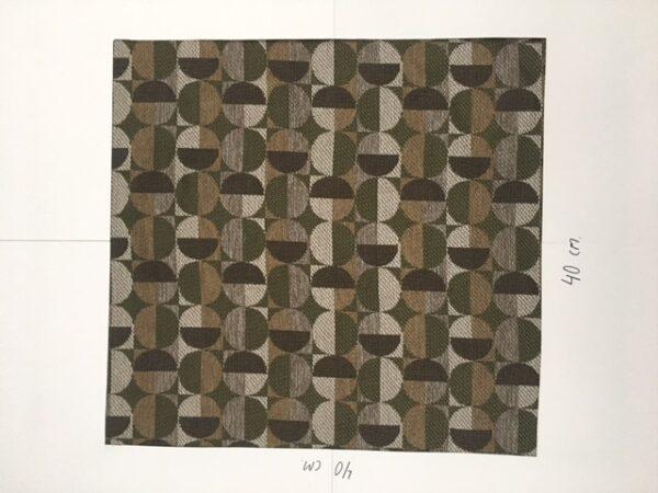 Møbelstof med mønster i cirkler i mørke farver.