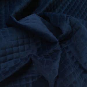 Quiltet velour i blå fra Skumhuset.